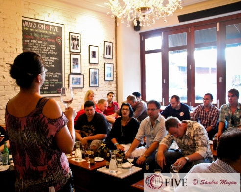 "Me with captive audience during an event at Five Bar, and by captive I mean ""waiting for the beer"" Photo by Sandra Megan for Five Bar"