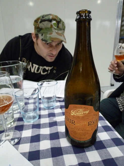 Derek reading the back of the beer. Derek is a home brewer who got to brew a GABS beer with Red Duck - check out his story at http://www.hophead.com.au/centennial-men/