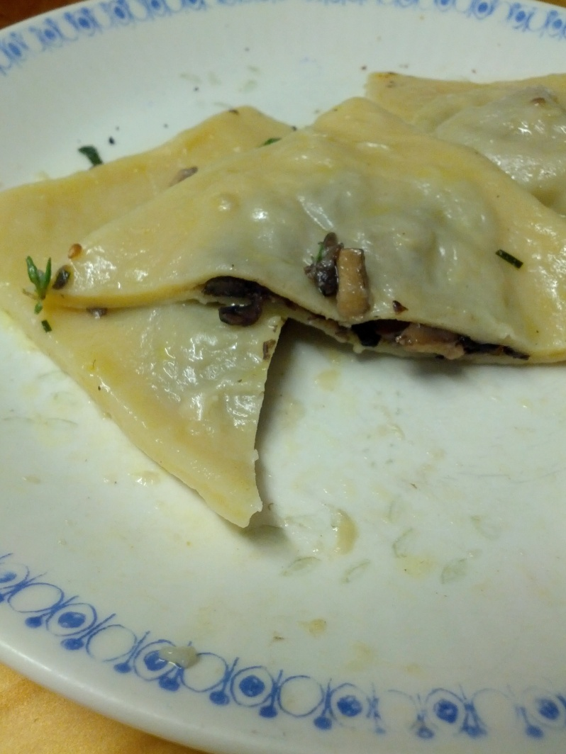 Homemade Mushroom, Chive & Goats Cheese Beer Ravioli, tossed in Parmesan and Fresh Thyme