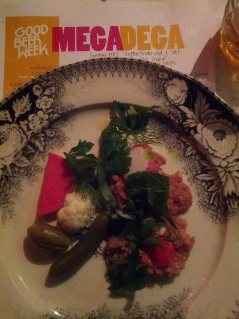 Beef kibbeh nayeh, crisp flat bread, fresh herbs, cucumber & radish crudités, Lebanese & Iranian pickled vegetables